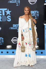 Eva Marcille brought some bohemian charm to the 2017 BET Awards with this printed off-the-shoulder maxi dress by Fillyboo.