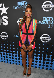 Issa Rae went for simple styling with a pair of black thin-strap heels.