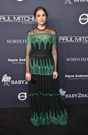 Olivia Culpo went for elegant styling with a black satin clutch.