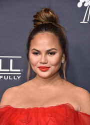Chrissy Teigen kept it fun with this top knot at the 2017 Baby2Baby Gala.