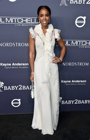 Kelly Rowland went the frilly route in a white Lanvin lace-panel gown with a ruffled neckline and shoulders at the 2017 Baby2Baby Gala.