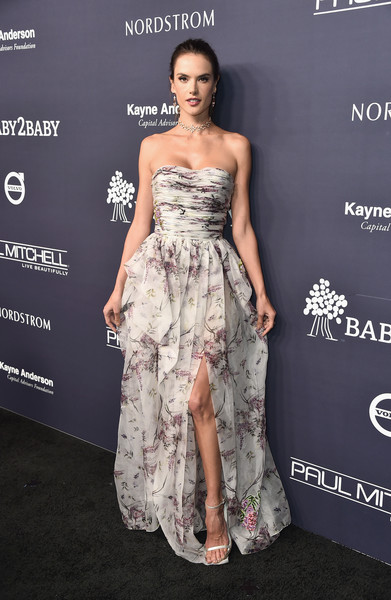 Alessandra Ambrosio paired her gorgeous dress with silver ankle-strap sandals by Stuart Weitzman.