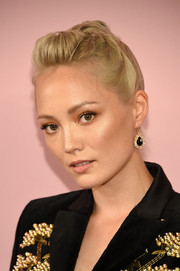 Pom Klementieff styled her hair into a twisty pompadour for the 2017 CFDA Fashion Awards.