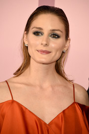 Olivia Palermo went for a punky beauty look with heavy eye makeup.