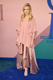 Brit Marling coordinated her top with a handkerchief-hem satin skirt, also by Sies Marjan.