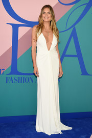 Heidi Klum worked a down-to-the-navel neckline in this white Zac Posen gown at the 2017 CFDA Fashion Awards.