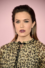 For her beauty look, Mandy Moore went the edgy route with dark lipstick and heavily lined eyes.