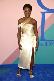 Lupita Nyong'o was modern-glam in an asymmetrical gold midi dress by Jason Wu at the 2017 CFDA Fashion Awards.