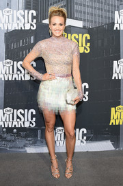 Carrie Underwood paired her dazzling dress with gold multi-strap sandals.