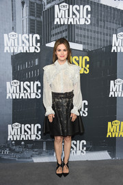Rachel Bilson contrasted her modest top with an edgy studded leather skirt, also by Rodarte.