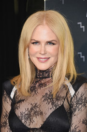 Nicole Kidman styled her hair into a simple center-parted 'do for the 2017 CMT Music Awards.