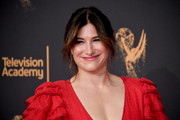 Kathryn Hahn looked romantic with her loose ponytail and parted bangs at the 2017 Creative Arts Emmy Awards.