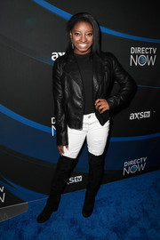 Simone Biles rounded out her look with black suede thigh-high boots.