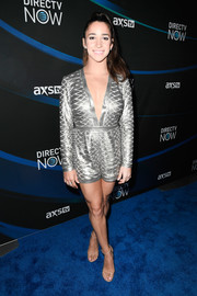 Aly Raisman kept it playful yet stylish in a deep-V silver romper at the 2017 DIRECTV NOW Super Saturday Night concert.
