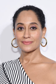 Tracee Ellis Ross jazzed up her look with a pair of gold hoops.