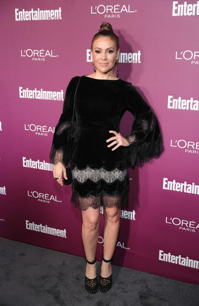Alyssa Milano gave her delicate dress a dose of edge with a pair of studded platform pumps.
