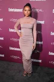 Karrueche Tran sheathed her slim figure in a body-con mauve maxi dress with peekaboo detailing for the Entertainment Weekly pre-Emmy party.