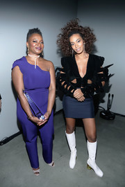 Solange Knowles' white knee-high boots added a retro touch.