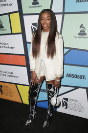 Estelle gave her look a futuristic punch with a pair of tall silver boots.