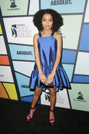 Yara Shahidi completed her ensemble with a metallic silver clutch.