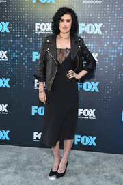 Rumer Willis sizzled in a cleavage-flaunting LBD, which she tempered with a leather moto jacket and  Swarovski bangles at the 2017 Fox Upfront.