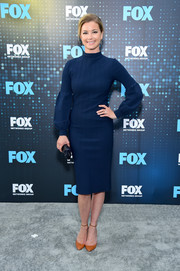 Emily VanCamp chose a modest yet chic Lela Rose midi dress with a high neck and bishop sleeves for the 2017 Fox Upfront.