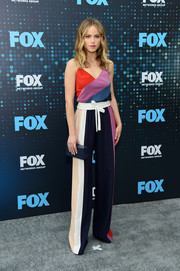 Halston Sage rounded out her look with a navy box clutch by Edie Parker.