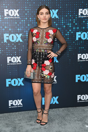 Camren Bicondova completed her ensemble with a mirrored box clutch by Blacksea.