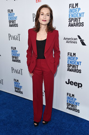Isabelle Huppert suited up in this red jacket and trousers combo for the 2017 Film Independent Spirit Awards nominees brunch.