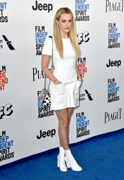 Riley Keough matched her dress with white ankle boots, also by Louis Vuitton.