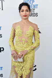 Freida Pinto paired a marbled box clutch by Edie Parker with a sexy illusion gown for the 2017 Film Independent Spirit Awards.