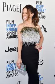 Kate Beckinsale accessorized with a mirrored box clutch by L'Afshar at the 2017 Film Independent Spirit Awards.