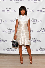 Kerry Washington complemented her dress with gold platform sandals by Jimmy Choo.