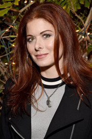Debra Messing wore her hair loose with a center part and flippy ends at the 2017 Gersh Emmy party.