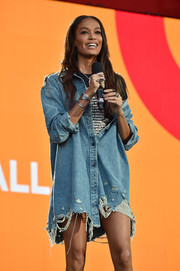 Joan Smalls was grunge-chic in a distressed denim shirtdress at the 2017 Global Citizen Festival.