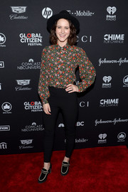 Rachel Brosnahan kept it modest in a floral blouse buttoned all the way up to her neck at the 2017 Global Citizen Festival.