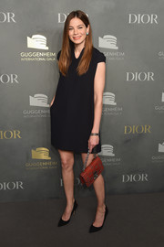 Michelle Monaghan dressed up her plain frock with a studded red leather purse, also by Dior.