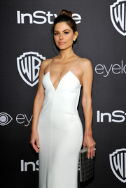 Maria Menounos attended the InStyle and Warner Bros. Golden Globes post-party sporting a silver clutch and white slip dress combo.