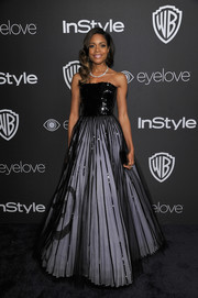 Naomie Harris swept into the InStyle and Warner Bros. Golden Globes post-party wearing an Armani Privé strapless ball gown boasting a sequined bodice and a sheer-overlay skirt.