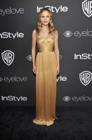 Halston Sage looked impeccable in a pleated strapless gown by Maria Lucia Hohan at the InStyle and Warner Bros. Golden Globes post-party.
