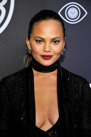 Chrissy Teigen sported a tight ponytail at the InStyle and Warner Bros. Golden Globes post-party.