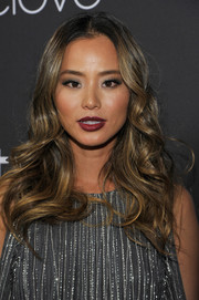 Jamie Chung attended the InStyle and Warner Bros. Golden Globes post-party wearing her hair in a cascade of curls.