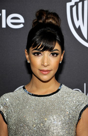 Hannah Simone worked a voluminous knot and her signature bangs at the InStyle and Warner Bros. Golden Globes post-party.