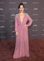 Dakota Johnson was a stunner in a pleated pink Gucci gown with a plunging neckline and silver beading at the 2017 LACMA Art + Film Gala.