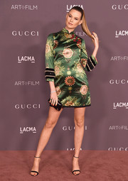 Behati Prinsloo rounded out her look with a black Gucci satin clutch.