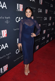 Gina Rodriguez polished off her sleek and sophisticated look with gold Stuart Weitzman sandals.