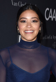 Gina Rodriguez styled her hair into a casual center-parted chignon for the 2017 Los Angeles Dance Project Gala.