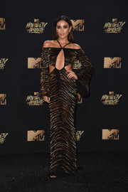 Shay Mitchell hit the 2017 MTV Movie and TV Awards looking racy in a tiger-patterned cutout gown by Roberto Cavalli.