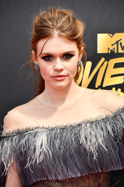 Holland Roden pulled her tresses back into a messy ponytail for the 2017 MTV Movie and TV Awards.