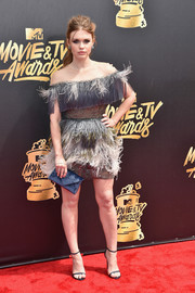Holland Roden got all frilled up in a feathered gray Tadashi Shoji cocktail dress with an illusion neckline for the 2017 MTV Movie and TV Awards.